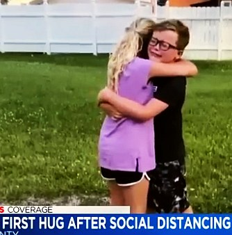 two cousins and best friends first hug after many weeks of social distancing